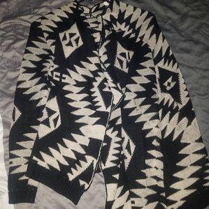 Adam Levine brown and black sweater